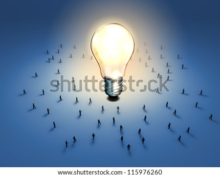 A group of tiny people walking towards a light bulb - stock photo