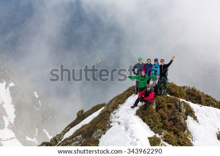 a group of tourists on a mountain top - stock photo