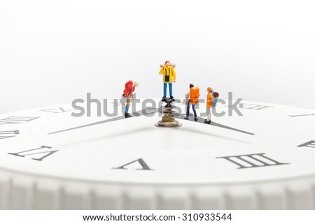 a group of travelers walk on the clock - stock photo