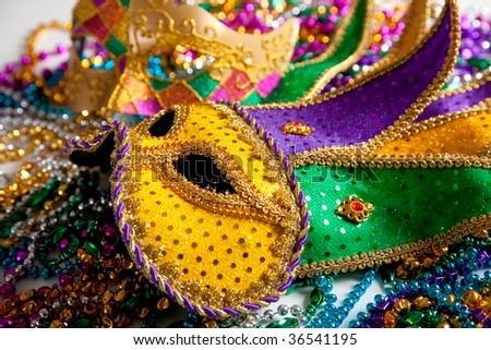 A group of two mardi gras mask and beads - stock photo