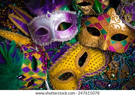 A group of venetian, mardi gras mask or disguise on a dark background - stock photo