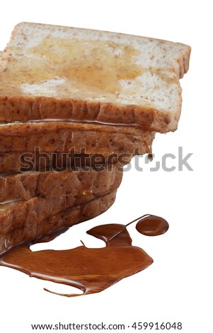 a group of whole wheat bread with honey on top. ready to eat in the morning  - stock photo