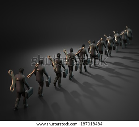 A group of wind-up toy business man - control concept - stock photo