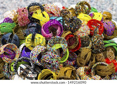 a group of wristband made of beads. - stock photo