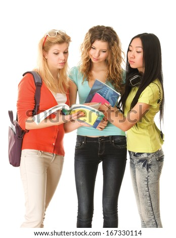 A group of young college girls standing with book, isolated on white background - stock photo