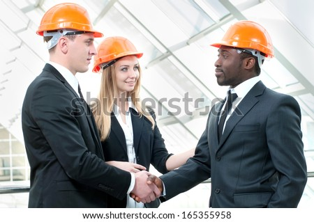 A group of young engineers at the present site of the business discussion - stock photo