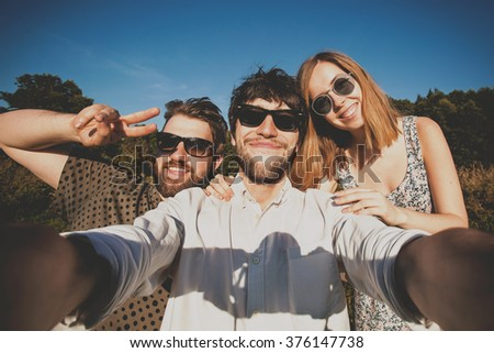 A group of young good looking multiethnic hipster friends do selfie photo portrait in Central park, New York - stock photo