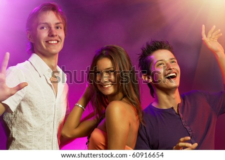 A group of young happy dancing people - stock photo