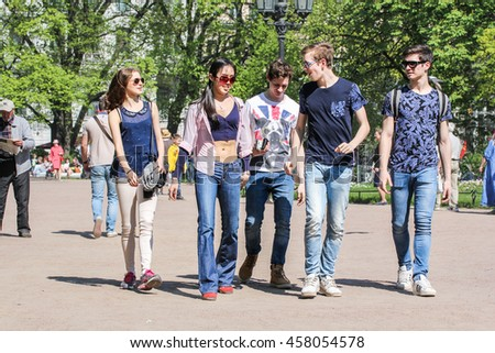 A group of young people. St. Petersburg, Russia - 9 May, 2016. Vacationers people on the lawns and gardens in the city.