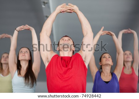A group of young people stretching in aerobics class
