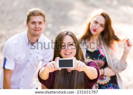 A group of young people taking a selfie together.
