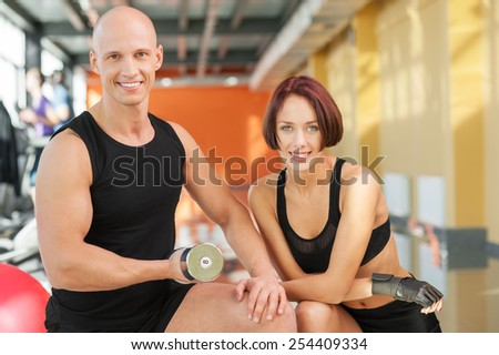 A group of young people training with dumbbell at the gym - stock photo