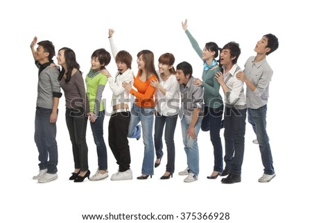 A group of young people waiting in line - stock photo