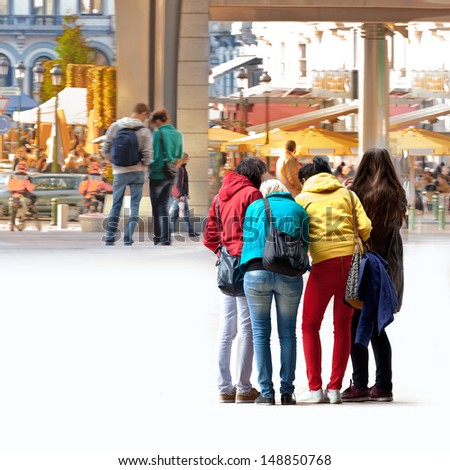 A group of young tourists. Urban scene. - stock photo