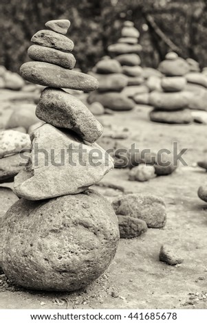 A grouping of small cairns near Oak Creek on the Red Rocks Crossing hike in Sedona, AZ. - stock photo