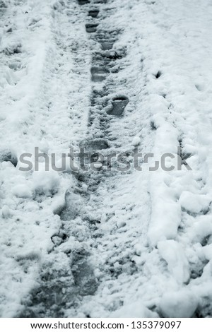 a grunge and dirty footpath in the snow