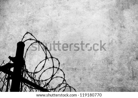 A grunge parchment with barbed wire fencing to show access restrictions for many inferences including prison, war and and borders. - stock photo