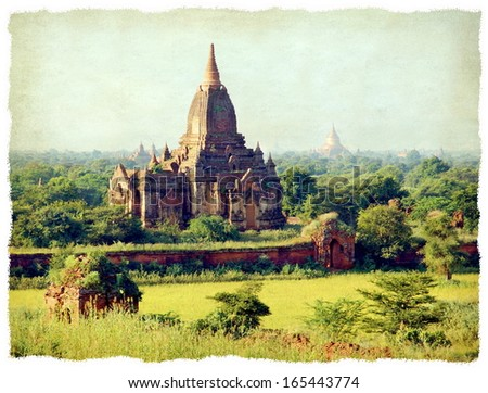 A grunge texture gives a vintage look at he famous pagoda's in the Valley of Bagan in Myanmar , Asia - stock photo