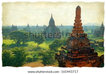 A grunge texture gives a vintage look at the famous pagoda's in the Valley of Bagan in Myanmar , Asia