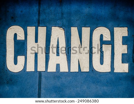 A Grungy Blue Conceptual Sign Saying Change In White Letters - stock photo