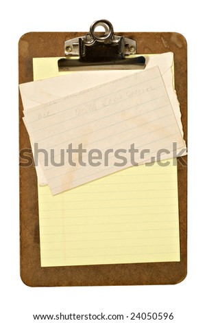 A grungy old clipboard holding an envelope, yellow paper, and letter with faint writing. File has clipping path.