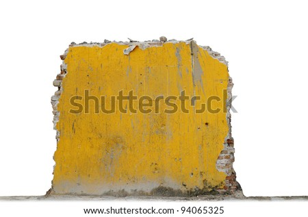 A grungy stained broken brick wall isolated against white. - stock photo