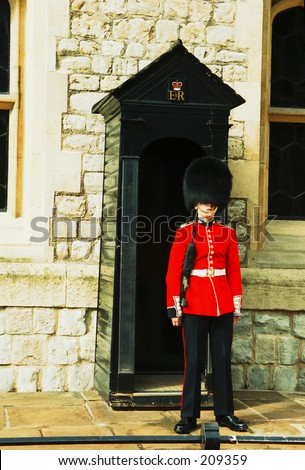 A guard on the entrance to the Crown Jewels, Tower of London, UK.