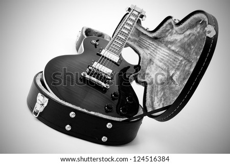 a guitar and case - stock photo