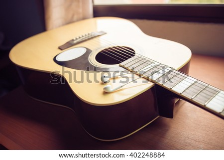 A guitar , close up,Vintage style photo with custom white balance, color filters, soft focus effect, and some fine film grain added - stock photo