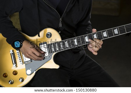 A guitarist playing with a electric guitar.