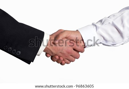 A gulf business man shake hand with a western business man - stock photo