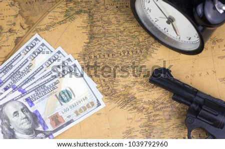 Gun alarm clock american dollar bill stock photo royalty free a gun alarm clock and american dollar bill on a world map of united states gumiabroncs Image collections