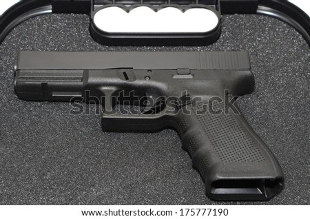 A gun lying in a carrying case. - stock photo