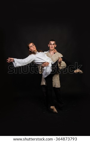 A guy and a girl dancing on a black background