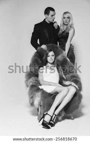 A guy and two girls in the room, tense. Human feelings - jealousy, love, passion, betrayal. - stock photo