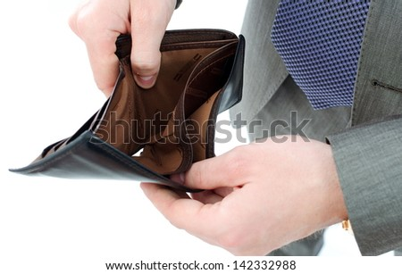 a guy holding an empty purse - stock photo