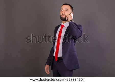 A guy in a nice suit with a mobile phone