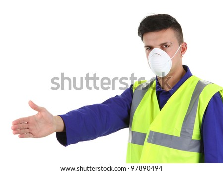 A guy wearing a dust mask, isolated on white - stock photo