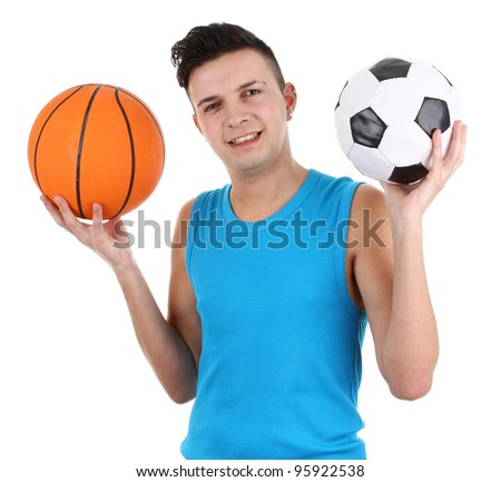A guy with a football and a basketball, isolated on white - stock photo