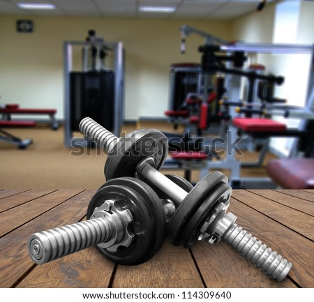 a gym Weights, and stationary equipment - stock photo