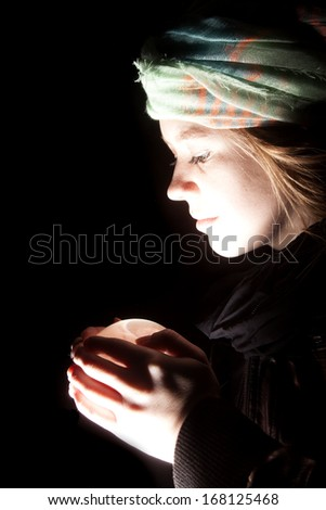 a gypsy looking at her crystal ball. - stock photo