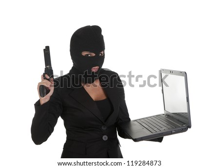a hacker, committing a crime  through laptop