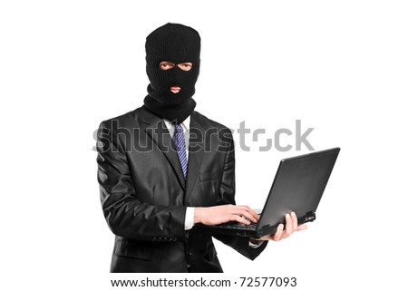 A hacker working on a laptop isolated against white background