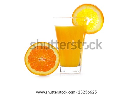 A half and glass of fresh orange juice reflected on white background. Shallow depth of field