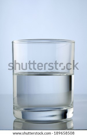 A half full glass of water - stock photo