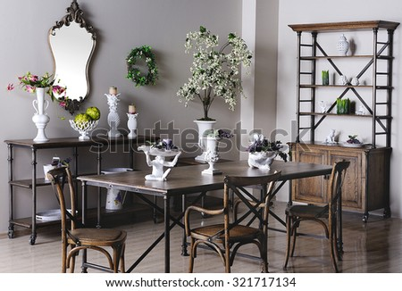 a hall of a showroom with furniture,vases and other decorative accessories - stock photo