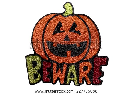 A Halloween Jack O Lantern with the word Beware beneath. Made from coloured glitter - stock photo