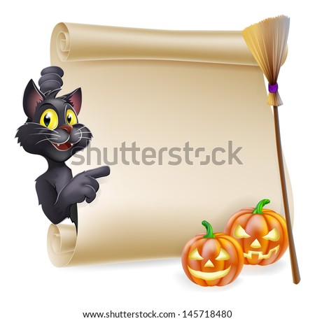 A Halloween scroll with black cat pointing at the scroll sign and carved Halloween pumpkins and witch's broom stick  - stock photo