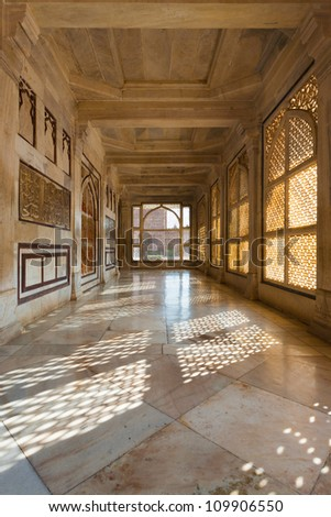 A hallway with beautiful intricate lattice windows in the central white marble tomb of Salim Chishti in the main courtyard at Fatehpur Sikri in Agra, India - stock photo