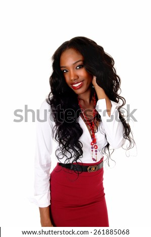 A halve length picture of a black girl in a white blouse and red skirt and